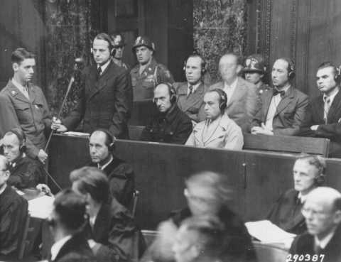 "Otto Ohlendorf, commander of Einsatzgruppe D (mobile killing unit D), during Trial 9 of the Subsequent Nuremberg Proceedings. This photograph shows Ohlendorf pleading ""not guilty"" during his arraignment at the Einsatzgruppen Trial. Nuremberg, Germany, September 15, 1947."