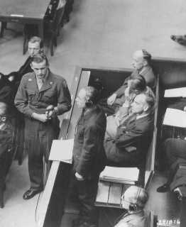 """Defendant Otto Schwarzenberger pleads """"not guilty"""" at his arraignment during the RuSHA Trial. October 10, 1947."""