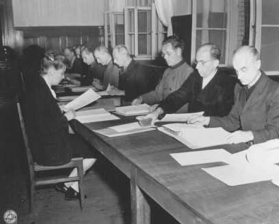The 14 RuSHA Trial defendants read the indictments against them. July 7, 1947.