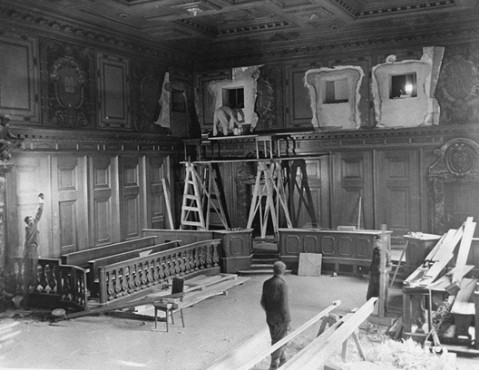 Repairs and improvements are made to the courtroom where the International Military Tribunal trial of war criminals will be held. The holes in the walls at the top will house radio commentators and public address operators. September 11, 1945.