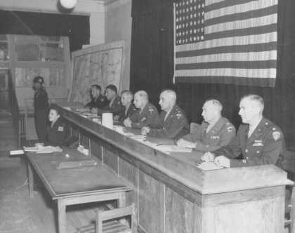 Judges in the trial of 19 men accused of committing atrocities at the Dora-Mittelbau concentration camp, located near Nordhausen. Dachau, Germany, September 25, 1947.