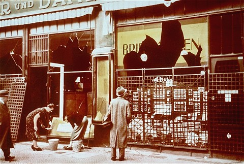 "Storefronts of Jewish-owned businesses damaged during the Kristallnacht (""Night of Broken Glass"") pogrom. Berlin, Germany, November 10, 1938."