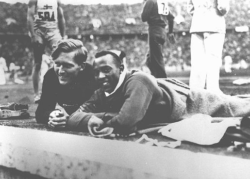 Athletes Jesse Owens of the United States (right) and Lutz Long of Germany at the Olympic stadium. Berlin, Germany, 1936.