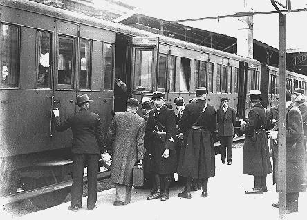 Jewish deportees, guarded by French police, board a train at the Austerlitz station for transport to the Pithiviers internment camp. Paris, France, May 1941.