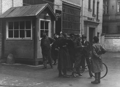 Police search a messenger employed by the Social Democratic newspaper VORWAERTS. Berlin, Germany, March 4, 1933.