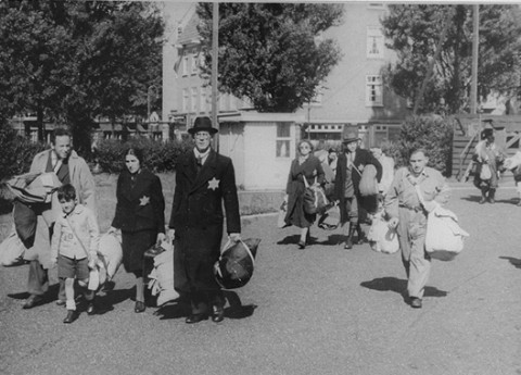 Jews proceed to an assembly point before deportation from Amsterdam. Amsterdam, the Netherlands, June-September 1943.