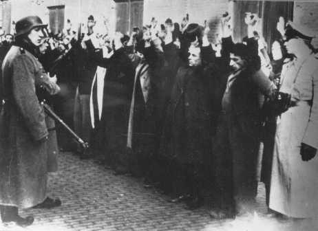 German police round up Jews in the Jewish quarter of Amsterdam, blockaded following anti-Nazi violence. Amsterdam, the Netherlands, February 22, 1941.
