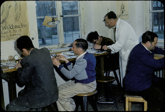 Jewish displaced persons study watchmaking in the Foehrenwald Organization for Rehabilitation through Training (ORT) school. Foehrenwald was the final displaced persons camp to close, functioning until 1957 as a home for Jews who had no place to go. Foehrenwald, Germany, 1953.