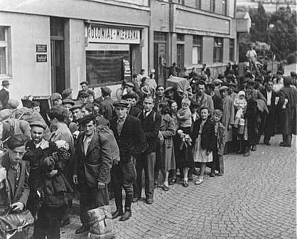 Jewish refugees, part of Brihah—the postwar flight of Jews—in line at a relief center. They are en route to the Allied occupation zones in Germany and Austria. Nachod, Czechoslovakia, 1946.