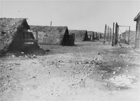 A view of barracks in the Kaufering network of subsidiary camps of the Dachau concentration camp. Landsberg-Kaufering, Germany, after April 27, 1945.