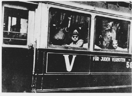 "Streetcar in Belgrade bearing the sign: ""Forbidden to Jews."" Belgrade, Yugoslavia, 1941-1942"