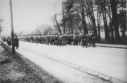 A view of a death march from Dachau. German civilians secretly photographed several death marches from the Dachau concentration camp as the prisoners moved slowly through the Bavarian towns of Gruenwald, Wolfratshausen, and Herbertshausen. Few civilians gave aid to the prisoners on the death marches. Germany, April 29, 1945.