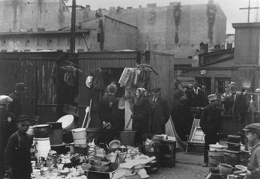 Scene in the Lodz ghetto marketplace. Jakubowicz's model of the Lodz ghetto recreates, on a small scale, the physical appearance of the ghetto, creating the shape of the model to mimic the exact boundaries, streets, and buildings that had a major impact on daily life in the ghetto. Lodz, Poland, between 1940 and 1944.