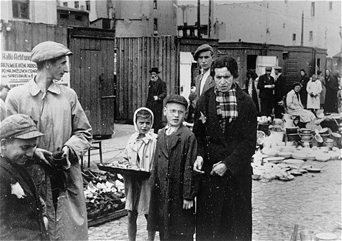 A child vendor among those selling miscellaneous wares at the market in the Lodz ghetto. Lodz, Poland, ca. 1941.