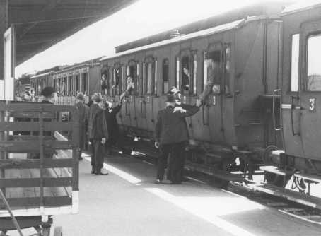 Departure of a train of German Jews being deported to Theresienstadt. Hanau, Germany, May 30, 1942.