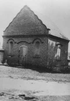 Postwar photograph of a building in Dabie where the possessions of Jews killed at the nearby Chelmno camp were stored. Dabie, Poland, June 1945.