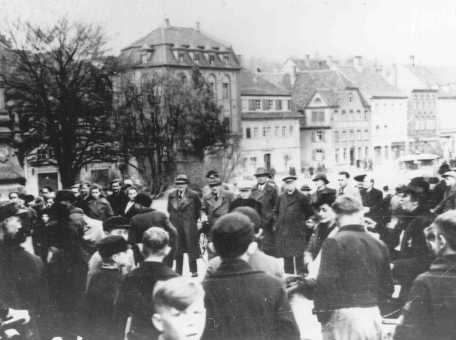 Jews in the German town of Kitzingen, northwest of Munich, assembled for deportation. Kitzingen, Germany, March 1942.