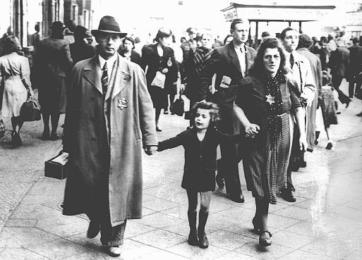 Members of a Jewish family walking along a Berlin street wear the compulsory Star of David. Berlin, Germany, September 27, 1941.