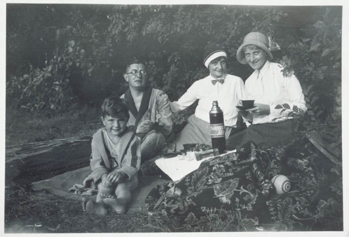 Fritz Glueckstein (left) on a picnic with his family in Berlin, Germany, 1932. Fritz's father was Jewish--he attended services in a liberal synagogue--and his mother was Christian. Under the Nuremberg Laws of 1935, Fritz  would be classified as mixed-raced (Mischling), but since his father was a member of the Jewish religious community, Fritz was classified as a Jew.