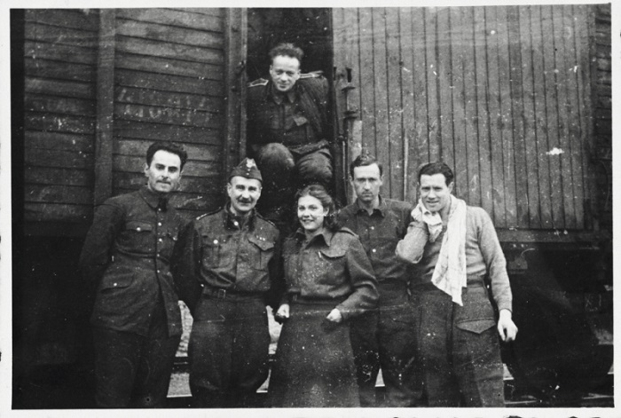 Six members of the Anders Army pose in front of a railcar prior to their departure for Iran. Krasnovodsk, Soviet Union, February 21, 1942.