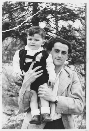 Josef Baldo, formerly a Bielski partisan, poses with his young son. Foehrenwald, Germany, ca. 1945.