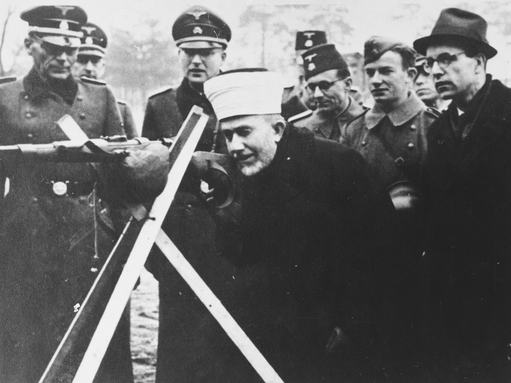 Hajj Amin al-Husayni in the company of German SS and Bosnian members of the Waffen-SS during an official visit to Bosnia, ca. 1943.