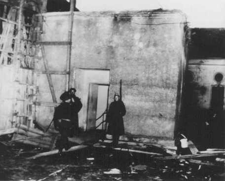 Soviet soldiers guard the entrance to Hitler's underground bunker. Upon the advance of Soviet forces through the streets of Berlin, Hitler committed suicide here on April 30, 1945, rather than face capture. Berlin, Germany, 1945.