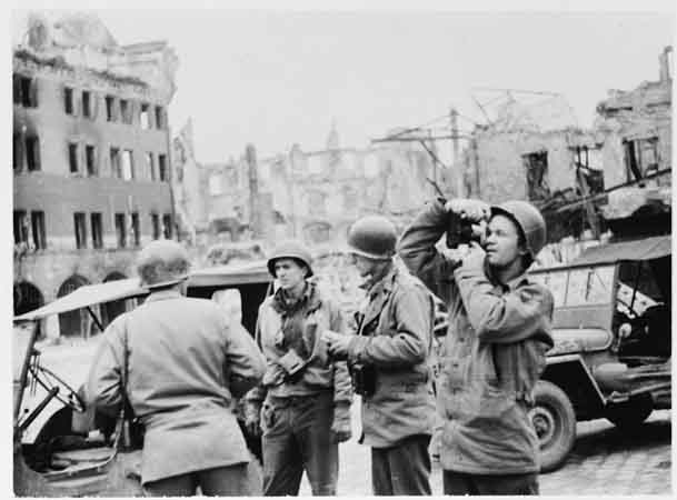 US Army Signal Corps photographers from Combat Unit 123 photograph ruins in the city of Naumburg, Germany. Photograph taken by J Malan Heslop. April 10, 1945.