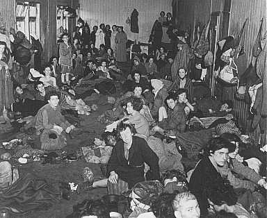 Romani (Gypsy) survivors in a barracks of the Bergen-Belsen concentration camp during liberation. Germany, after April 15, 1945.