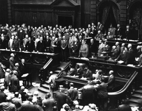 Chancellor Heinrich Bruening announces to the Reichstag (German parliament) President Hindenburg's order for its dissolution and for new elections, invoking powers granted to him under the Weimar Constitution. Berlin, Germany, July 18, 1930.