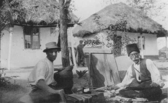 Two Romani (Gypsy) artisans. Ploesti, Romania, 1930s.