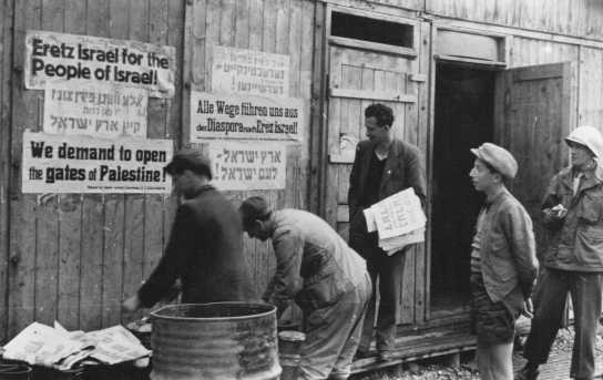 Jewish displaced persons put up signs demanding open immigration into Palestine. Feldafing displaced persons camp, Germany, after May 1945.