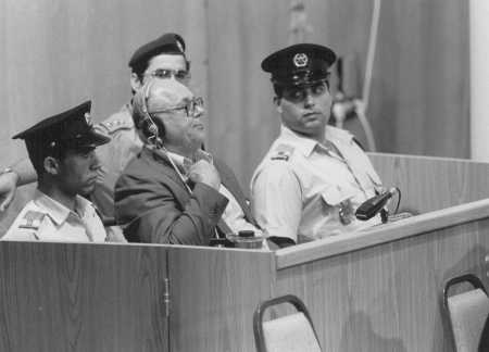 Defendant John Demjanjuk crosses his heart upon hearing the pronouncement of his death sentence.  Jerusalem, Israel, April 25, 1988.
