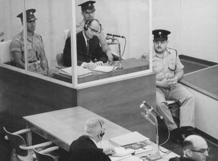 Defendant Adolf Eichmann takes notes during his trial in Jerusalem in 1961.