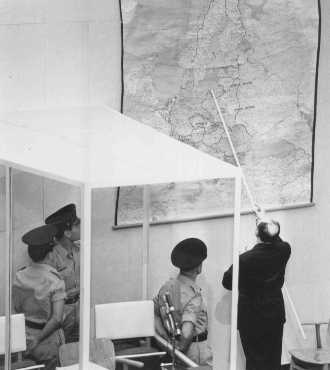 Defendant Adolf Eichmann identifies the city of Danzig (Gdansk) on a map during his trial in Jerusalem. Israel, July 18, 1961.