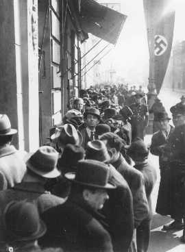 Jews wait in front of the Polish Embassy for entrance visas to Poland after Germany's annexation of Austria. Vienna, March or April 1938.