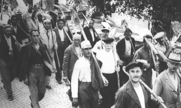 Jews drafted into the Hungarian Labor Service System march to a work site. Szeged, Hungary, between 1940 and 1944.