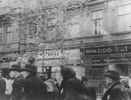 Elderly Jews are transferred from their assigned houses to a ghetto area. Budapest, Hungary, November or December 1944.