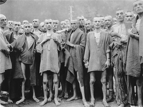 Prisoners at the time of liberation of the Ebensee camp, a subcamp of the Mauthausen concentration camp. This photograph was taken by Signal Corps photographer Arnold E. Samuelson. Austria, May 7, 1945.