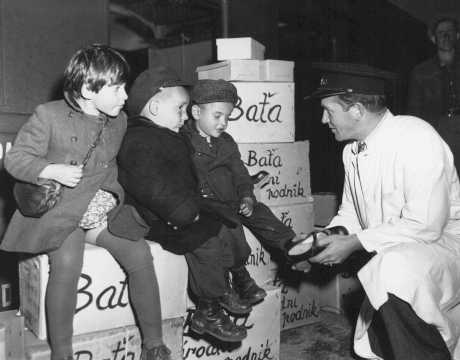 Jewish orphans fleeing Europe are fitted with shoes from the United Nations Relief and Rehabilitation Administration (UNRRA), en route to Allied occupation zones in Germany and Austria. Prague, Czechoslovakia, August 25, 1946.