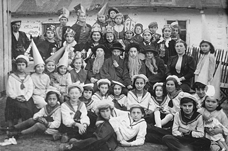 Group portrait of students at the Beis Yaakov religious school for girls dressed in costumes to celebrate the holiday of Purim. Kolbuszowa, Poland, March 1938.