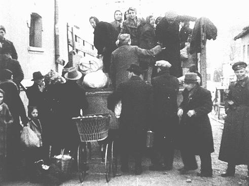Bulgarian authorities round up Jews in occupied Macedonia for deportation. They were first held in a camp in Skopje and then deported to the Treblinka killing center in German-occupied Poland. Skopje, Yugoslavia, March 1943.