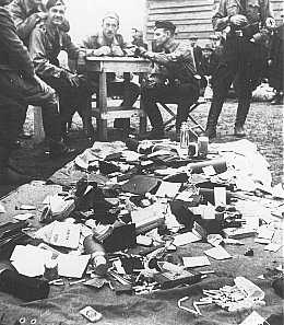 Ustasa (Croatian fascist) guards alongside belongings of prisoners at the Jasenovac concentration camp. Yugoslavia, between 1941 and 1945.