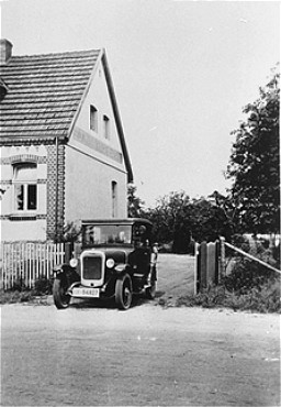 The Kusserow family home in Bad Lippspringe. The family kept religious materials in the trunk of the car and distributed them from it as well.The Kusserow family was active in their region distributing religious literature and teaching Bible study classes in their home. Their house was conveniently situated for fellow Witnesses along the tram route connecting the cities of Paderborn and Detmold. For the first three years after the Nazis came to power, the Kusserows endured moderate persecution by local Gestapo agents, who often came to search their home for religious materials. In 1936, Nazi police pressure increased dramatically, eventually resulting in the arrest of the family and its members' internment in various concentration camps. Most of the family remained incarcerated until the end of the war. Bad Lippspringe, Germany, 1933-1937.
