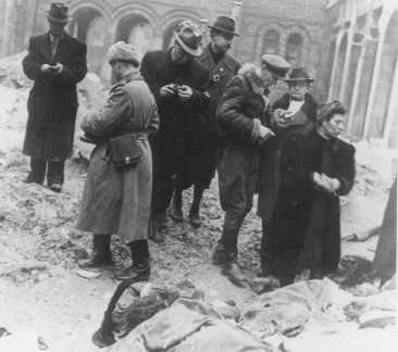 Families and friends of Jewish victims killed in the Budapest ghetto search for the exhumed corpses of friends and relatives. Budapest, Hungary, January, 1945.