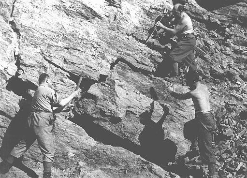Jewish forced laborers in the quarry of a forced-labor camp established by the Hungarian government. Tokaj, Hungary, 1940.