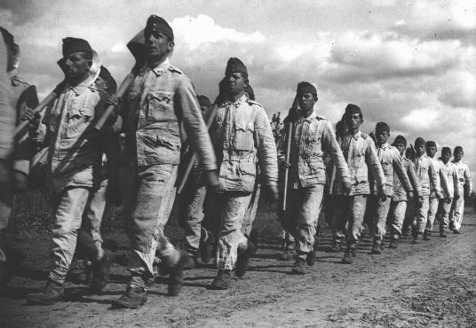 Conscripts in the Hungarian Labor Service march to a work site. Mateszalka, Hungary, September 1939.