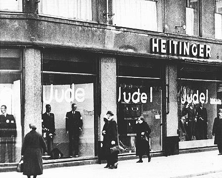"Windows of a Jewish-owned store painted with the word ""Jude"" (Jew). Berlin, Germany, June 19, 1938."