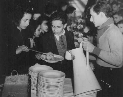 Children who arrived in Great Britain on Children's Transports (Kindertransporte) from Germany and Austria take a meal in Harwich. Great Britain, December 14, 1938.