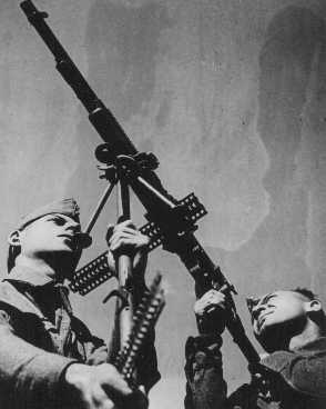 Soldiers from the British army's Palestine Buffs Regiment, composed of volunteers from Palestine, at anti-aircraft exercises. This regiment was a precursor to the Jewish Brigade Group. Palestine, October 14, 1944.